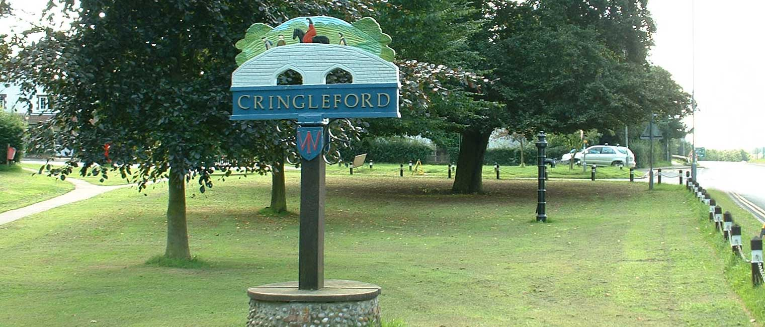 Cringleford Sign and Trees on Green
